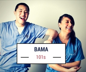 Two students holding a sign saying B A M A 1 0 1