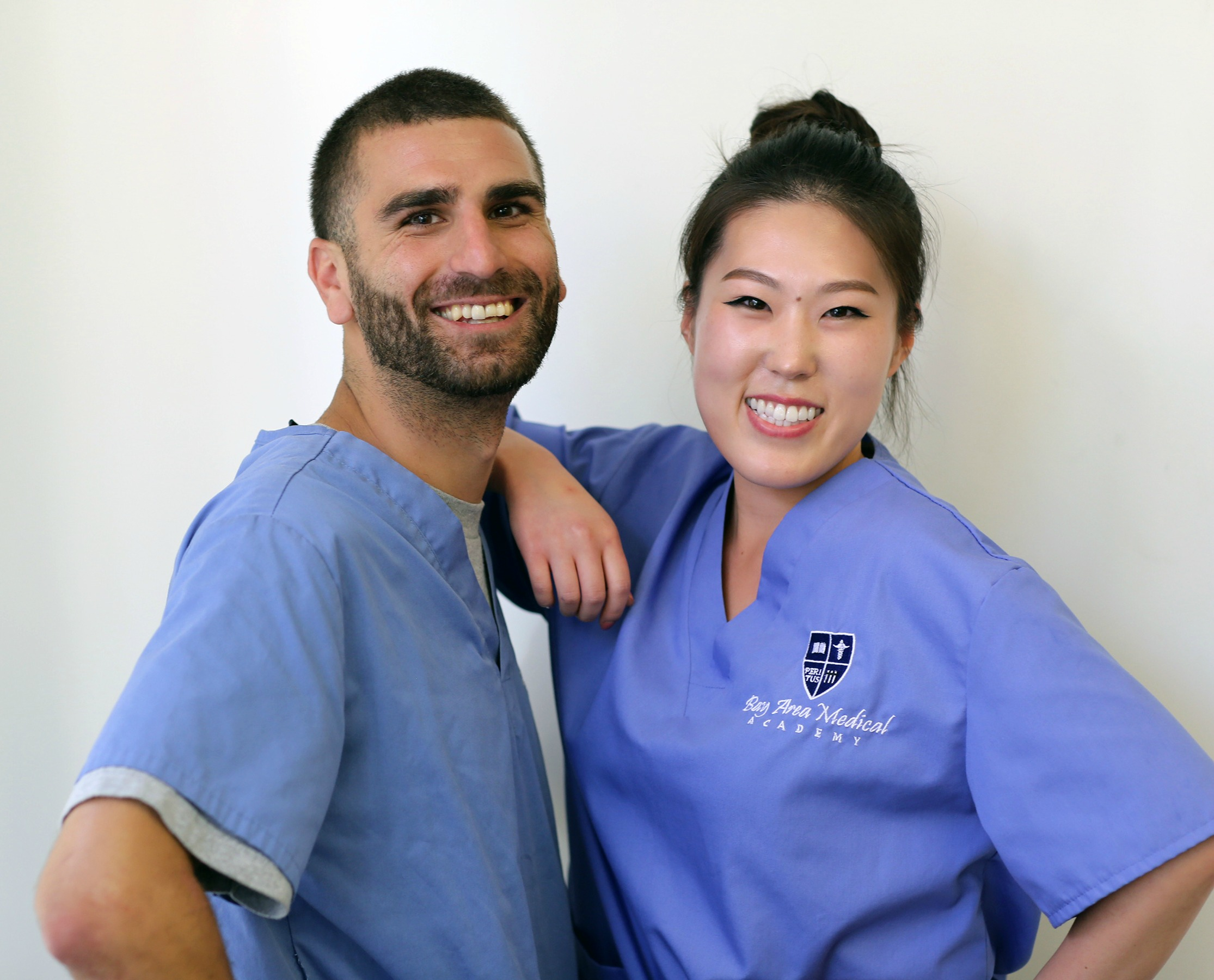 Two smiling B A M A medical assistant students