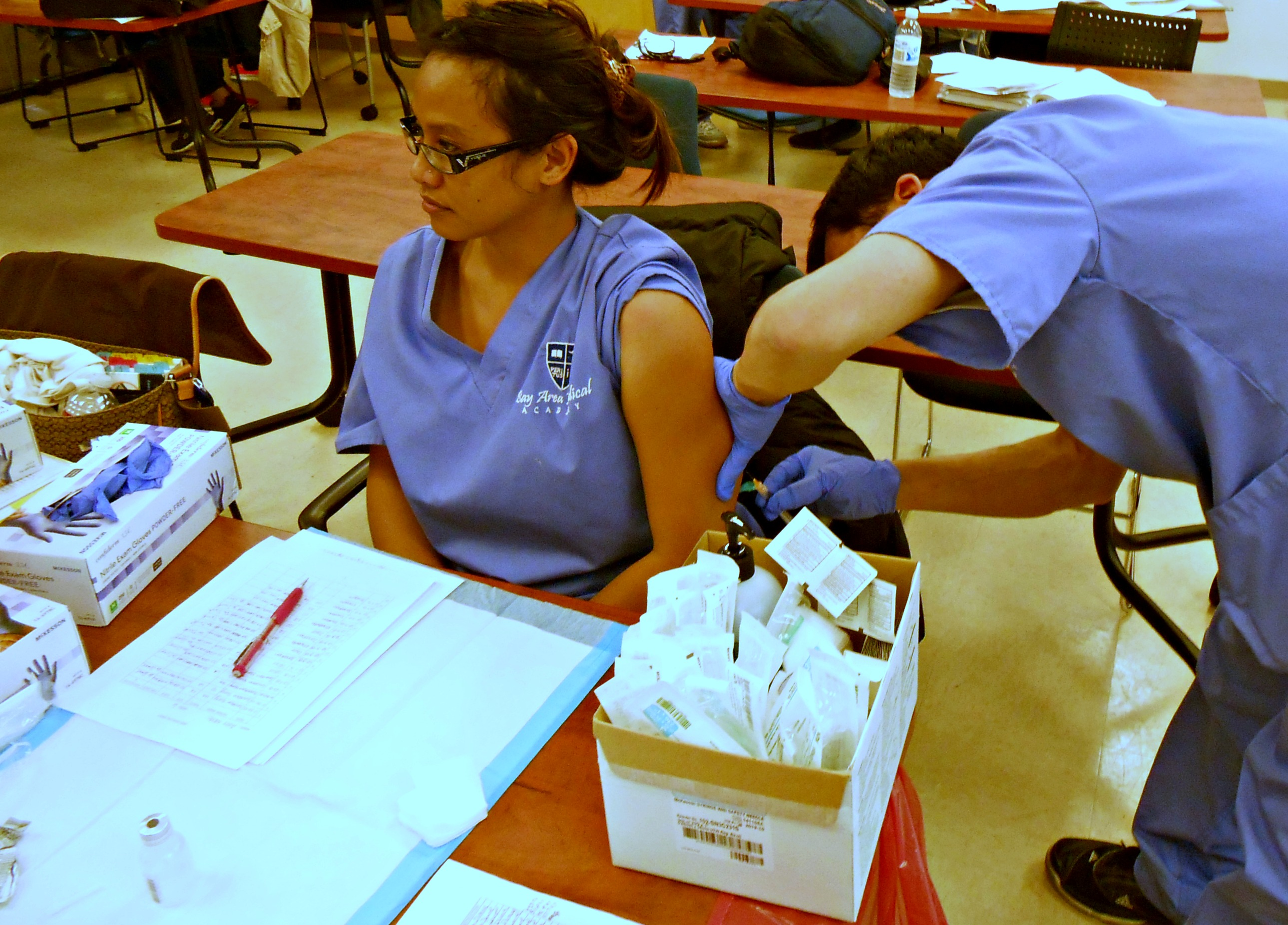 A medical assistant volunteering their time
