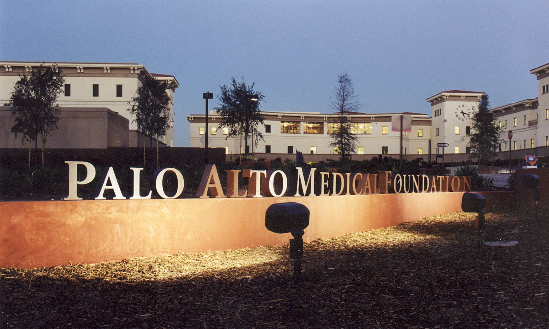 Lit up building sign for the Palo Alto Medical Foundation.