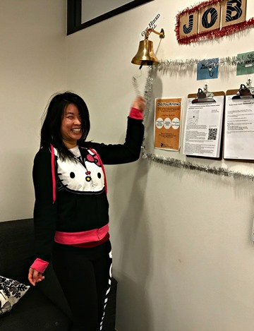 pharmacy tech program student ringing just hired bell